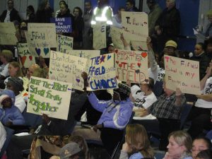 Image of Signs of protest after Boston School Committee Votes Unanimously to Close or Merge 12 Schools.