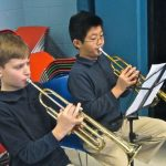 We were playing our trumpets and looking at the music which tells us which notes to play. In third grade we got to try four different instruments with Making Music Matter; this year we chose one. We've learned the scale and harmonic finger pattern. ~ James Tobin & Ryan Ho, Grade 4