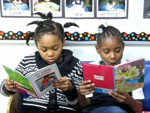 We are reading books we like. We are learning to read and write. We are learning a lot of things! ~ Lillian Ekechakwu & Kalydah Michel