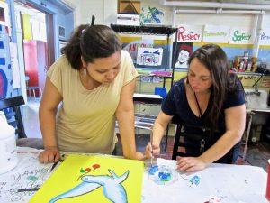 student and teacher in art class