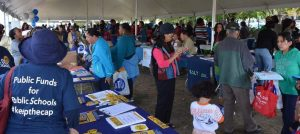Parents look at books at Back to School fair