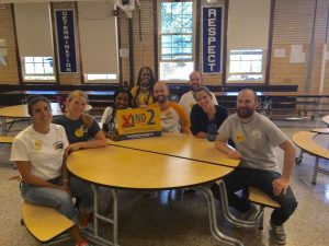 Photo of Henderson teachers sitting at table