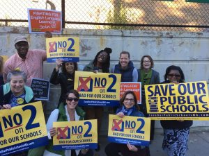 Image of The Henry Grew Cougar Teachers letting Hyde Park commuters know what to do on November 2nd! #NoOn2 #Good4You