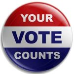 "image of lapel button with ""your vote counts"" on it"