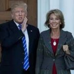 photo of trump and betsy devos