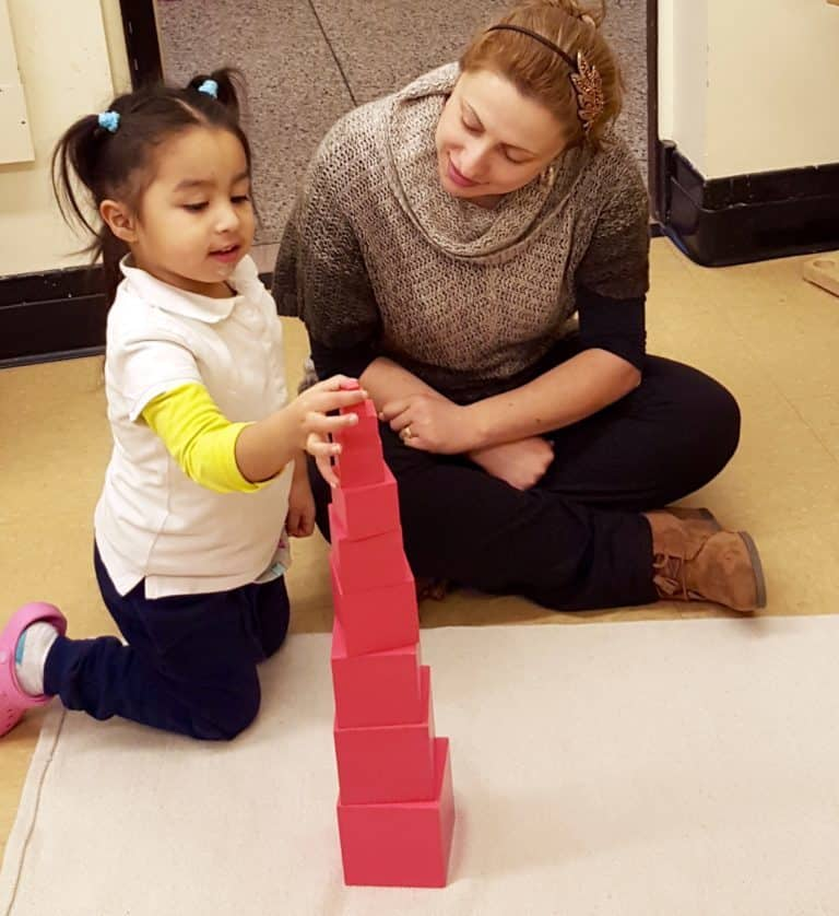 teacher and student build with blocks