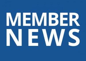 "blue rectangle with text ""member news"""