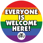 "Rainbow circle with text ""everyone is welcome here"""