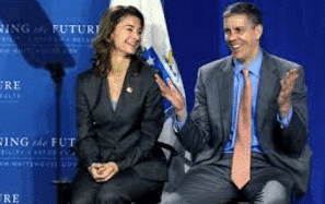 Melinda Gates and Arne Duncan share a chuckle (probably) at our expense.