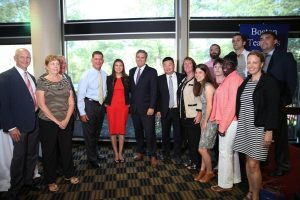 Image of BTU leaders celebrate a tentative contract agreement with Boston Mayor Marty Walsh and Boston Schools SuperintendentTommy Chang.