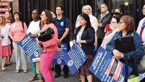 BPS teachers rally in support of immigrant students at the Bruce Bolling Municipal Building.